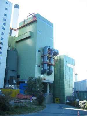 Warmte-isolatie aan een rookgasreinigingsinstallatie met geveltechniek.